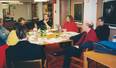 Bill Harris, Thelma Beoder (hidden), HRI curator Bruce Montgomery, staff liaison Ellen Moore, former AIUSA board member Abe Bonowitz, oral history consultant and CU/HRI staffer Susan Whalen, former board member Dave Stamps, former AIUSA board chair Mary Gray working at Norlin Library, University of Colorado-Boulder,  at the 1999 meeting.