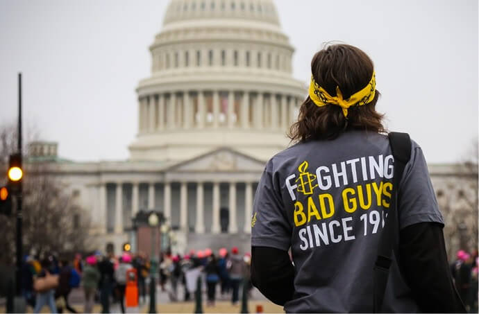 An Amnesty Activist in front of Capitol Hill