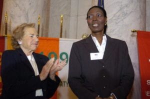 The Director of Dominican Women of Haitian Descent Sonia Pierre (R) is applauded by Ethel Kennedy