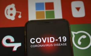 "In this photo illustration a smartphone screen reading ""Covid 19"""