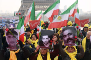 Demonstrators in Paris hold photos of Iran