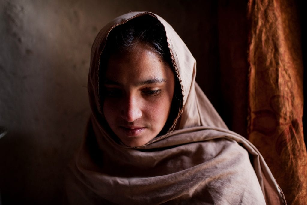 Bibi's oldest child, 15-year-old Marja, no longer goes to school as her mother fears she will be kidnapped for marriage. Bibi says the girl has received many offers of money and marriage proposals in recent months. / UNHCR / J. Tanner / March 2011